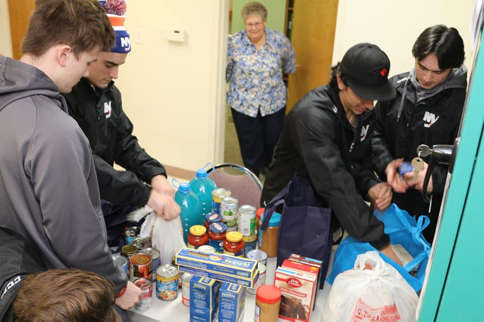 NCDC JR ISLANDERS collecting food for Maryhaven Center of